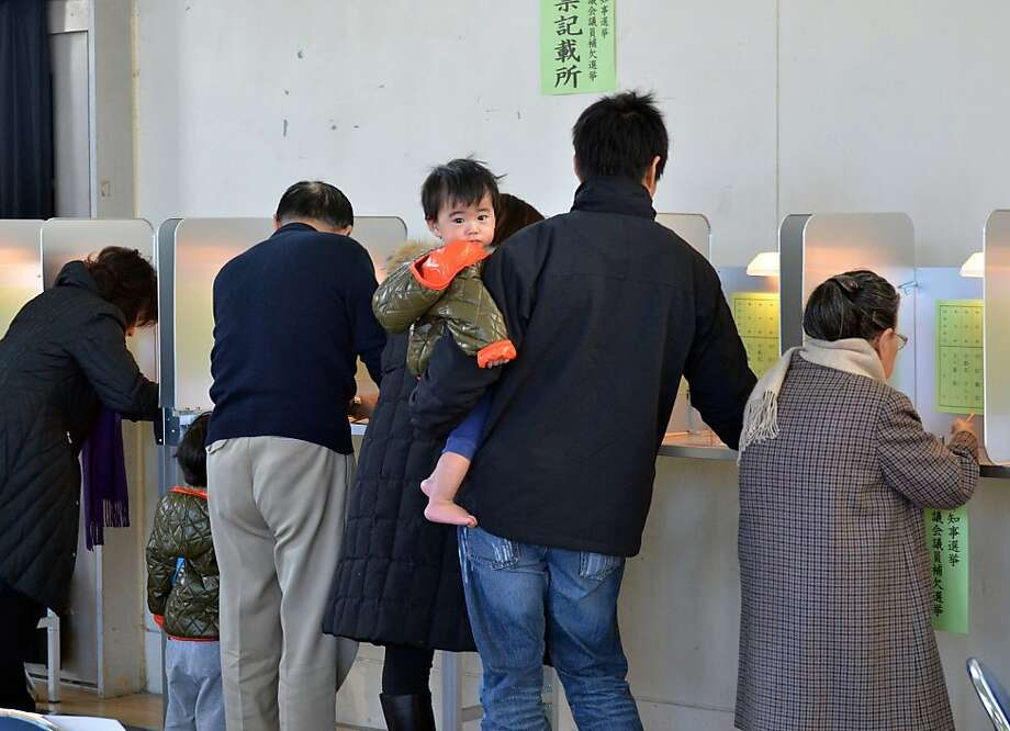Voters cast their ballots in Tokyo. Unofficial returns showed that the ruling Democratic Party of Japan was cast out of leadership, in a likely reaction to the economic slump. Photo: Yoshikazu Tsuno, AFP/Getty Images