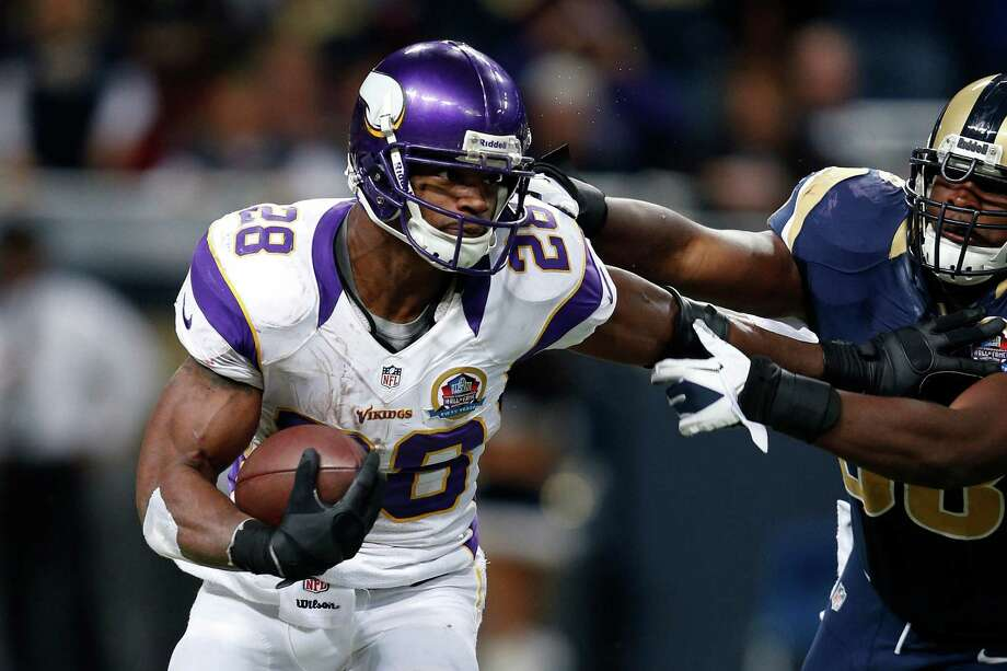 With 212 yards rushing against St. Louis on Sunday, Minnesota's Adrian Peterson is 294 shy of breaking the NFL single-season mark of 2,105 held by Eric Dickerson. Photo: Joe Robbins, Stringer / 2012 Getty Images