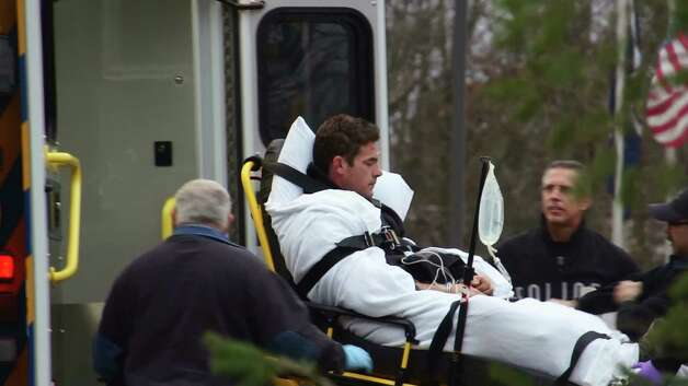 Jason Guynup is loaded into an ambulance on Sunday in East Greenbush after he crashed his truck and fled from police. (Marty Miller/Special to the Times Union)