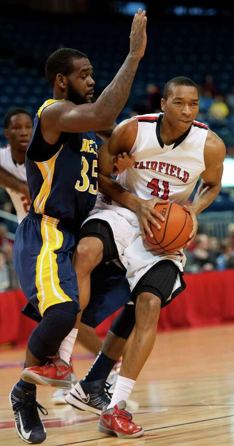 Fairfield University's Keith Matthews gets tangled up with Drexel University's Dartaye Ruffin during a men's basketball game played at the Webster Bank Arena, Bridgeport, CT on Sunday December 16th, 2012. Matthews will transfer from Fairfield. Photo: Mark Conrad / Connecticut Post Freelance