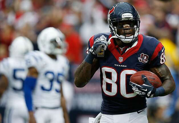 The Texans' Andre Johnson takes satisfaction in his first-quarter touchdown, one of 11 catches for 151 yards. Houston did not trail against Indianapolis. Photo: Scott Halleran, Getty Images