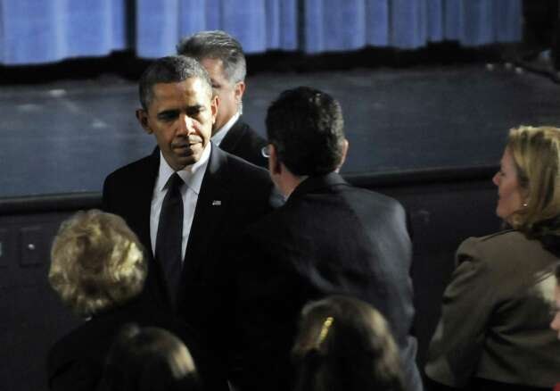 President Barack Obama greets Gov. Dannel Malloy during his arrival at the start of an interfaith vigil for the victims of the Sandy Hook Elementary School shooting on Sunday, Dec. 16, 2012 at Newtown High School in Newtown, Conn. A gunman walked into Sandy Hook Elementary School Friday and opened fire, killing 26 people, including 20 children. (AP Photo/The Hartford Courant, Stephen Dunn, Pool) Photo: AP