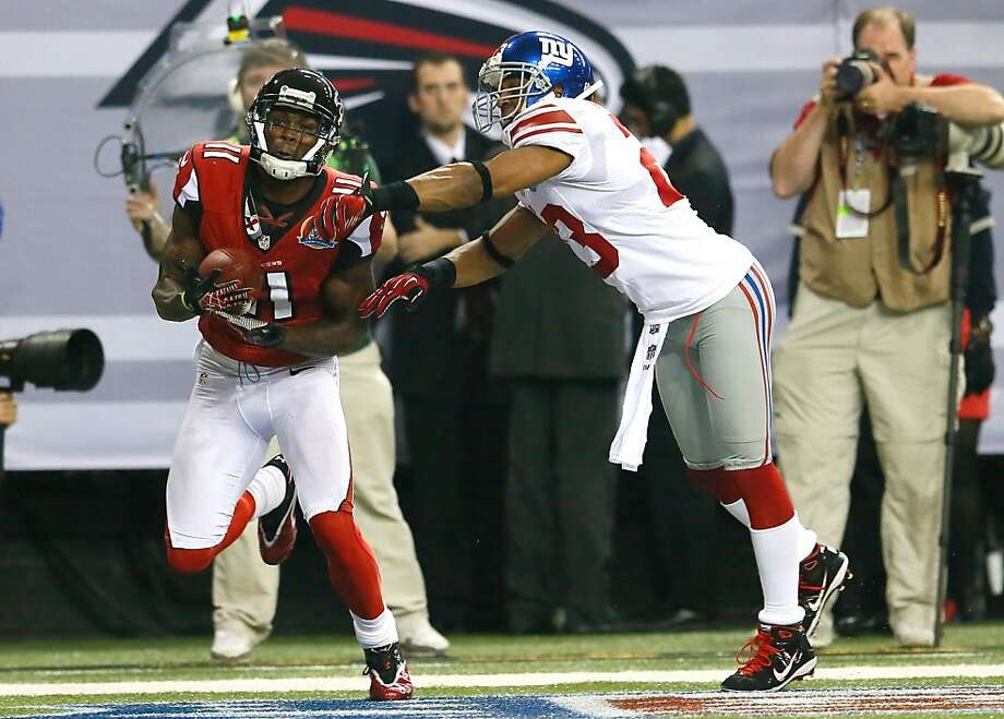 Falcons wide receiver Julio Jones (left) pulls in one of his two touchdown catches, beating the Giants' Corey Webster. Photo: Kevin C. Cox, Getty Images