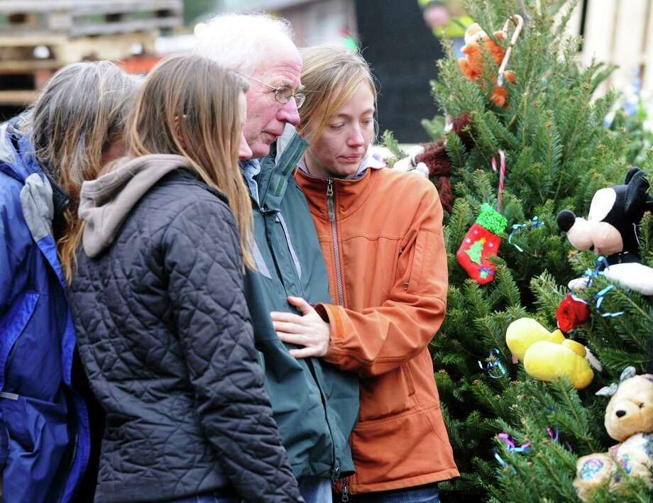 Mourners gathered outside Sandy Hook Elementary School, Sunday Dec. 16, 2012, in Newtown Conn. Twenty-seven people including 20 students were gunned down on Friday. Photo: Will Waldron, Hearst Newspapers/Will Waldron / The News-Times