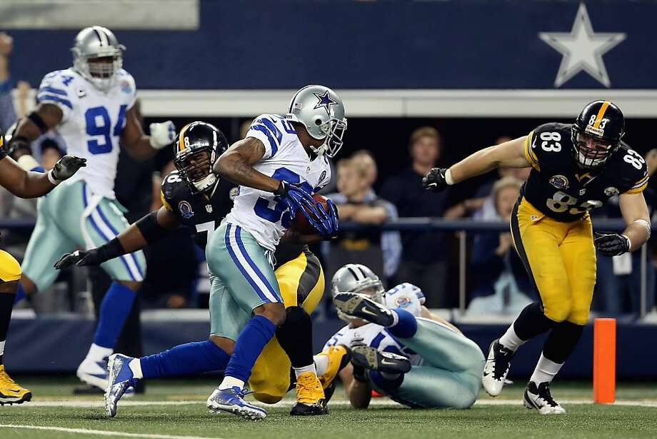 Brandon Carr returns an interception 36 yards to the Pittsburgh 1 to set up the Cowboys' winning field goal in overtime. Photo: Ronald Martinez, Getty Images