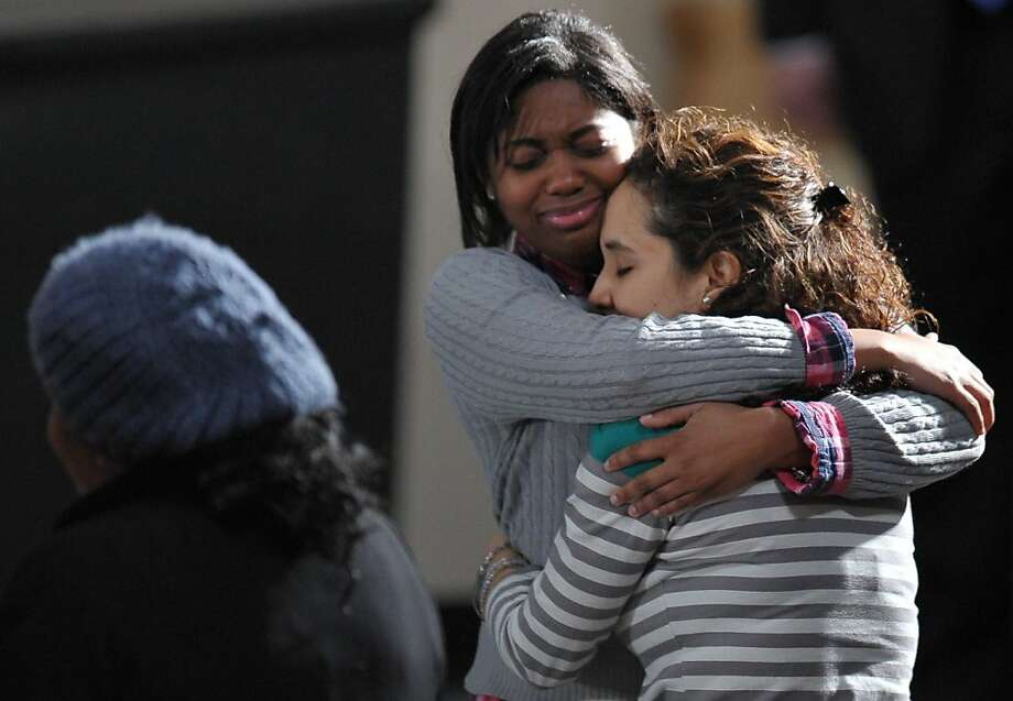 Two young women hug at a memorial service for the victims and relatives of the Sandy Hook Elementary School shooting on December 16, 2012 in Newtown, Connecticut. US President Barack Obama will address the memorial for the twenty-six people, 20 of them children, who were killed when a gunman entered Sandy Hook Elementary and began a shooting spree.  AFP PHOTO/Mandel NGANMANDEL NGAN/AFP/Getty Images Photo: Mandel Ngan, AFP/Getty Images