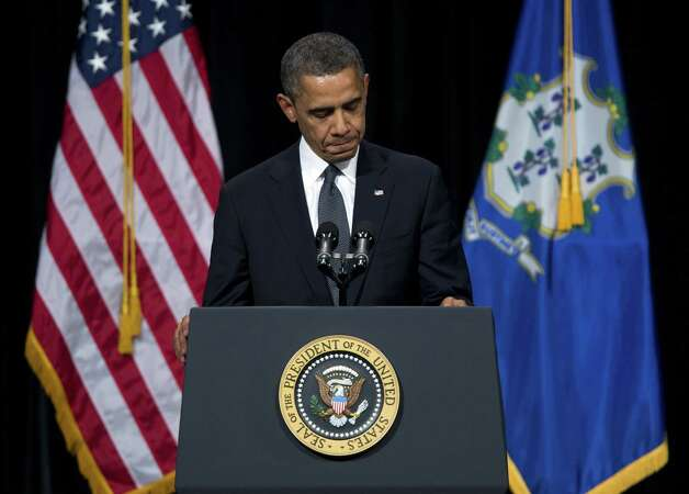 President Barack Obama pauses during a speech at an interfaith vigil for the victims of the Sandy Hook Elementary School shooting on Sunday, Dec. 16, 2012 at Newtown High School in Newtown, Conn.  A gunman walked into Sandy Hook Elementary School Friday and opened fire, killing 26 people, including 20 children. (AP Photo/ Evan Vucci) Photo: AP
