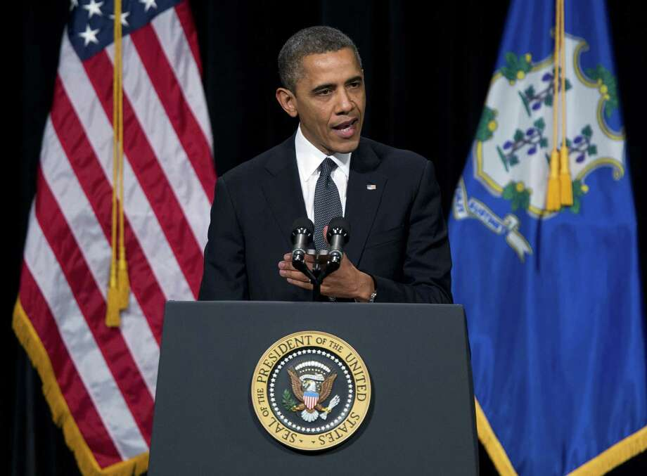 President Barack Obama speaks during an interfaith vigil for the victims of the Sandy Hook Elementary School shooting on Sunday, Dec. 16, 2012 at Newtown High School in Newtown, Conn.  A gunman walked into Sandy Hook Elementary School Friday and opened fire, killing 26 people, including 20 children.  (AP Photo/ Evan Vucci) Photo: AP