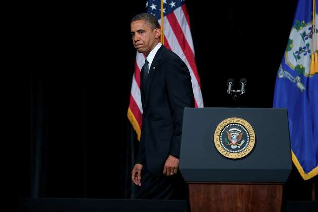 President Barack Obama walks off after delivering a speech at an interfaith vigil for the victims of the Sandy Hook Elementary School shooting on Sunday, Dec. 16, 2012 at Newtown High School in Newtown, Conn.  A gunman walked into Sandy Hook Elementary School Friday and opened fire, killing 26 people, including 20 children.  (AP Photo/Evan Vucci) Photo: AP