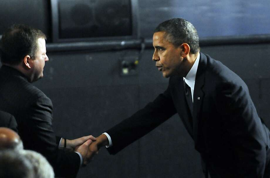 NEWTOWN, CT - DECEMBER 16:  U.S. President Barack Obama is greeted by R-Fairfield, John McKinney, the Ct. Senate minority leader, before being seated in the audience for the 90 minute service on December 16, 2012 at Newtown High School in Newtown, Connecticut. Twenty-six people were shot dead, including twenty children, after a gunman identified as Adam Lanza opened fire at Sandy Hook Elementary School. Lanza also reportedly had committed suicide at the scene. A 28th person, believed to be Nancy Lanza, found dead in a house in town, was also believed to have been shot by Adam Lanza. (Photo by Stephen Dunn-Pool/Getty Images) Photo: Pool, Getty Images