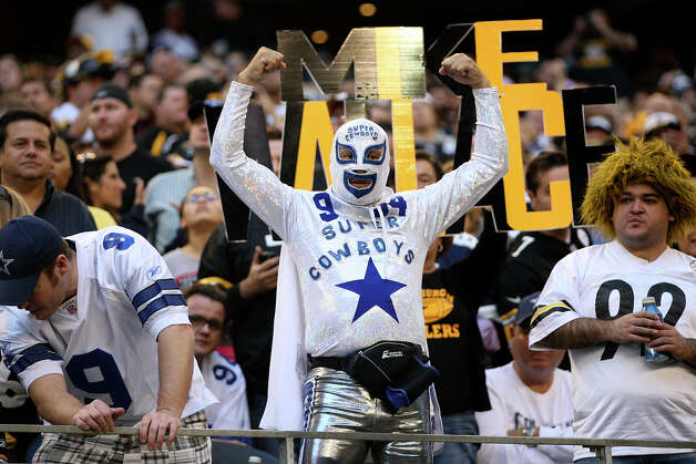 Fans dress up as the Dallas Cowboys take on the Pittsburgh Steelers at Cowboys Stadium in Arlington, Texas, Sunday, Dec. 16, 2012. Photo: Jerry Lara, Express-News / © 2012 San Antonio Express-News