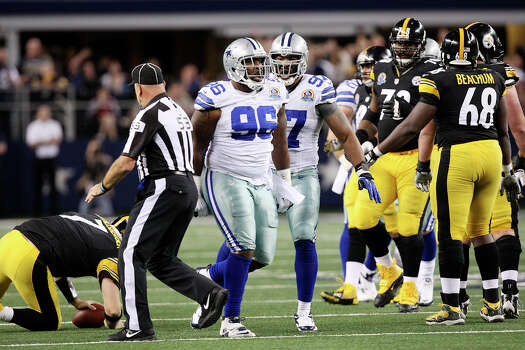 Dallas Cowboys' defensive tackle Marcus Spears, (96), celebrates after sacking Pittsburgh Steelers' quarterback Ben Roethlisberger, left, during the second half at Cowboys Stadium in Arlington, Texas, Sunday, Dec. 16, 2012. The Cowboys won 27-24 in overtime. To the right of Spears is defensive tackle Jason Hatcher. Photo: Jerry Lara, Express-News / © 2012 San Antonio Express-News