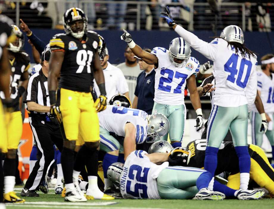 Dallas Cowboys' Eric Frampton, (27), and Danny McCray, (40), point in their favor after a punt return fumble by the Pittsburgh Steelers in the second half at Cowboys Stadium in Arlington, Texas, Sunday, Dec. 16, 2012. The Cowboys won 27-24 in overtime. Photo: Jerry Lara, Express-News / © 2012 San Antonio Express-News