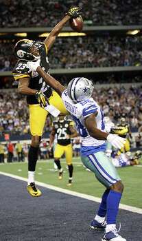 Pittsburgh Steelers' cornerback Keenan Lewis breaks up a pass intended for Dallas Cowboys' Dez Bryant during the second half at Cowboys Stadium in Arlington, Texas, Sunday, Dec. 16, 2012. The Cowboys won 27-24 in overtime. Photo: Jerry Lara, Express-News / © 2012 San Antonio Express-News