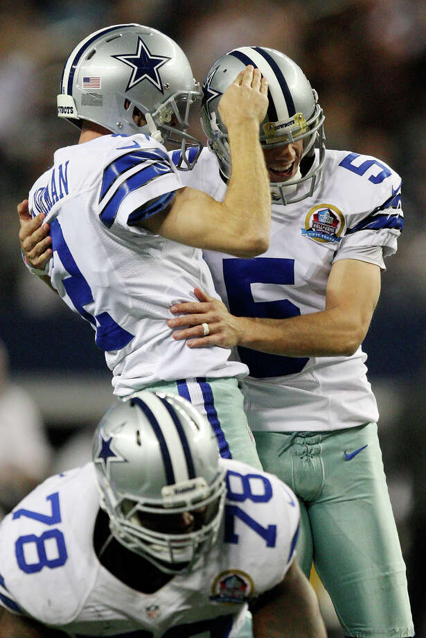 Dallas Cowboys' kicker Dan Bailey, right, celebrates with Brian Moorman after kicking the winning field goal in overtime against the Pittsburgh Steelers at Cowboys Stadium in Arlington, Texas, Sunday, Dec. 16, 2012. The Cowboys won 27-24. Photo: Jerry Lara, Express-News / © 2012 San Antonio Express-News