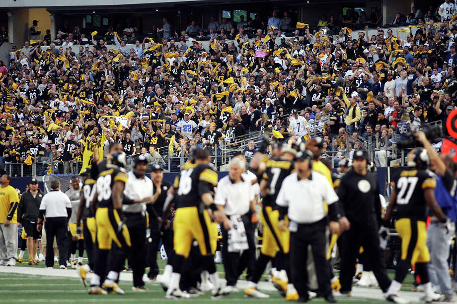 Pittsburgh Steelers fans celebrate a last second touchdown in the second half against the Dallas Cowboys at Cowboys Stadium in Arlington, Texas, Sunday, Dec. 16, 2012. Photo: Jerry Lara, Express-News / © 2012 San Antonio Express-News