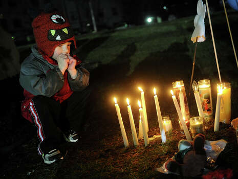 Sandy Hook Elementary pre-k student Connor Monaghan, 4 of Newtown, looks at the memorial to shooting victims outside Newtown High School where President Barack Obama spoke on Sunday, December 16, 2012. Photo: Brian A. Pounds / Connecticut Post