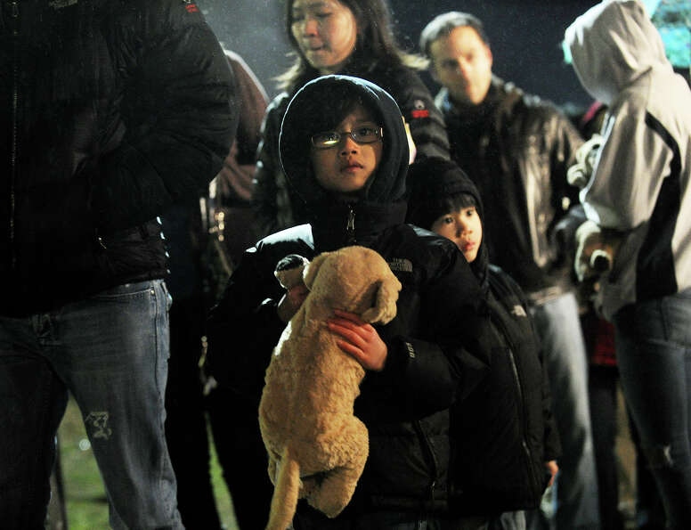 Long lines of people wait outside Newtown High School to attend a prayer vigil where President Barac