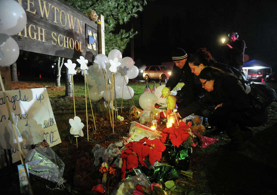 Visitors add to the memorial to shooting victims outside Newtown High School where President Barack Obama spoke on Sunday, December 16, 2012. Photo: Brian A. Pounds / Connecticut Post