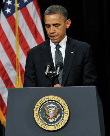 President Barack Obama addresses the nation during an interfaith vigil for the families and residents affected by the Sandy Hook Elementary School shooting at Newtown High School in Newtown, Conn., on Sunday, Dec. 16, 2012. Photo: Jason Rearick / The News-Times