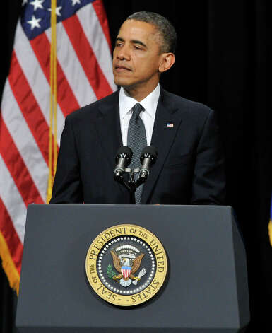President Barack Obama addresses the nation during an interfaith vigil for the families and residents affected by the Sandy Hook Elementary School shooting at Newtown High School in Newtown, Conn., on Sunday, Dec. 16, 2012. Photo: Jason Rearick
