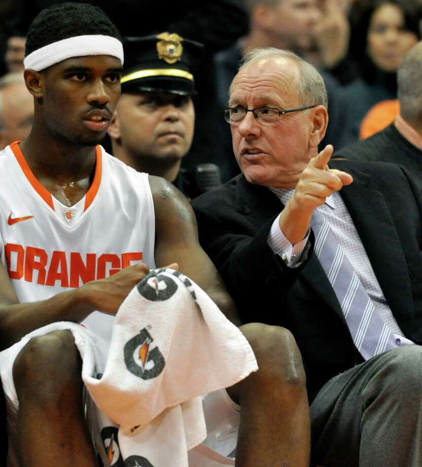 Syracuse head coach Jim Boeheim talks to C. J. Fair, left, during the second half against Canisius of an NCAA college basketball game in Syracuse, N.Y., Saturday, Dec. 15, 2012. Syracuse won 85-61. (AP Photo/Kevin Rivoli) Photo: KEVIN RIVOLI