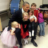 A photo from the Emilie Parker Fund Facebook page shows President Barack Obama meeting with children before the interfaith service at Newtown High School on Sunday, Dec. 16, 2012.