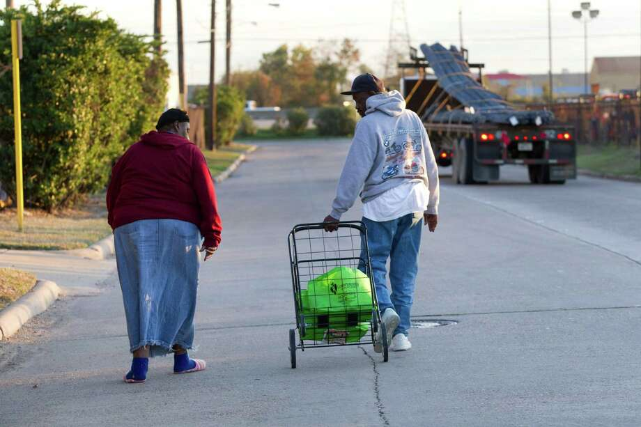 "In our car-loving society, people who cannot access transportation are excluded from their own communities and trapped inside ""transit deserts."" In this photo: Mary and Earnest Cager walk away from the Houston Food Bank on their way to a bus stop. Photo: Brett Coomer, Houston Chronicle / © 2012 Houston Chronicle"