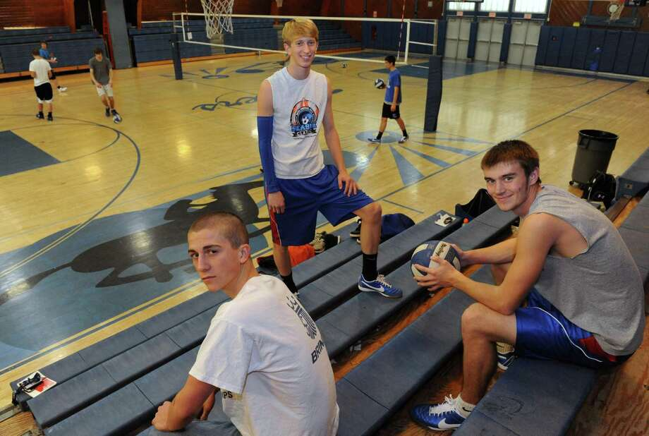 Ichabod Crane boys' volleyball players Derrick Fenoff, left, Tyler Jablanski, center, and Justyn Verbraska during practice in Valatie, NY Friday Dec. 14, 2012. (Michael P. Farrell/Times Union) Photo: Michael P. Farrell