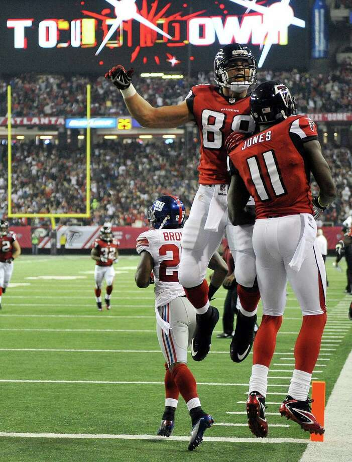 Atlanta Falcons tight end Tony Gonzalez (88) celebrates with wide receiver Julio Jones (11) after Jones scored a touchdown during the second half of an NFL football game against the New York Giants, Sunday, Dec. 16, 2012, in Atlanta. (AP Photo/Rich Addicks) Photo: Rich Addicks