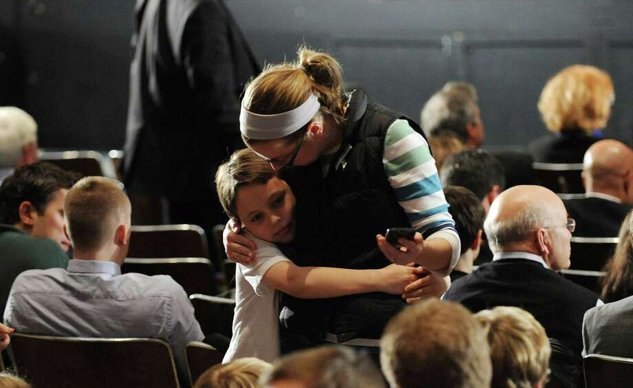 NEWTOWN, CT - DECEMBER 16:  Mourners comfort one another before U.S. President Barack Obama speaks at an interfaith vigil for the shooting victims from Sandy Hook Elementary School on December 16, 2012 at Newtown High School in Newtown, Connecticut. Twenty-six people were shot dead, including twenty children, after a gunman identified as Adam Lanza opened fire at Sandy Hook Elementary School. Lanza also reportedly had committed suicide at the scene. A 28th person, believed to be Nancy Lanza, found dead in a house in town, was also believed to have been shot by Adam Lanza. Photo: Pool, Getty Images / 2012 Getty Images