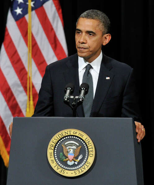 President Barack Obama addresses the nation during an interfaith vigil for the families and resident