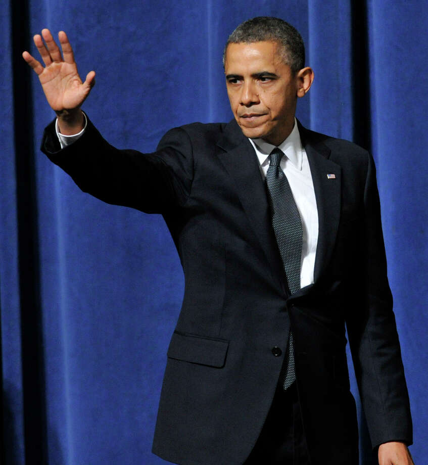 President Barack Obama waves to people after addresses the nation during an interfaith vigil for the families and residents affected by the Sandy Hook Elementary School shooting at Newtown High School in Newtown, Conn., on Sunday, Dec. 16, 2012. Photo: Jason Rearick / The News-Times