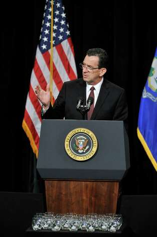 Connecticut Gov. Dannel P. Malloy addresses families and residents affected by the Sandy Hook Elementary School shooting during an interfaith vigil at Newtown High School in Newtown, Conn., on Sunday, Dec. 16, 2012. Photo: Jason Rearick / The News-Times