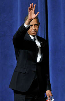President Barack Obama waves to people after he addressesed the nation during an interfaith vigil for the families and residents affected by the Sandy Hook Elementary School shooting at Newtown High School in Newtown, Conn., on Sunday, Dec. 16, 2012. Photo: Jason Rearick / The News-Times