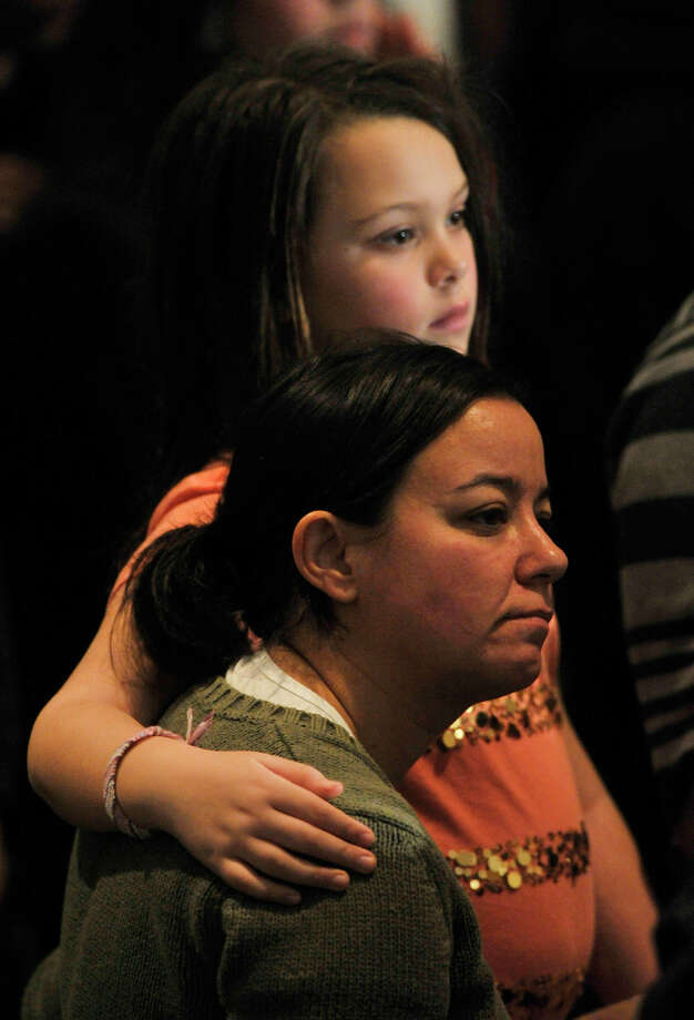 People listen in the audience during the interfaith vigil for the families and residents affected by the Sandy Hook Elementary School shooting at Newtown High School in Newtown, Conn., on Sunday, Dec. 16, 2012. Photo: Jason Rearick / The News-Times