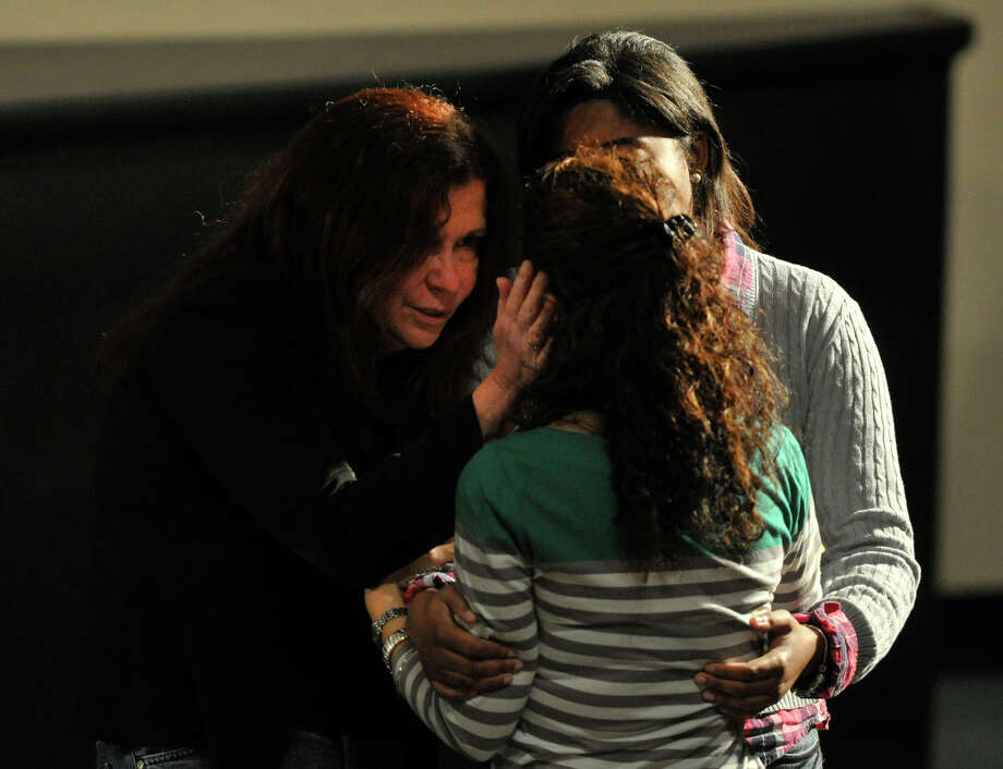 Friends and family console each other befoe the interfaith vigil for the families and residents affected by the Sandy Hook Elementary School shooting at Newtown High School in Newtown, Conn., on Sunday, Dec. 16, 2012. Photo: Jason Rearick / The News-Times