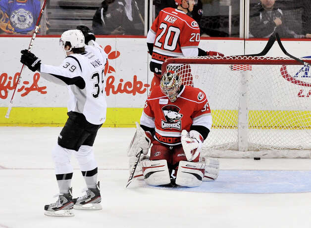 San Antonio Rampage's Justin Vaive, left, celebrates a Rampage goal against Charlotte Checkers goaltender Justin Peters during an AHL hockey game, Sunday, Dec. 16, 2012, in San Antonio. Charlotte won 2-1. Photo: Darren Abate, Darren Abate/pressphotointl.com / Darren Abate/pressphotointl.com