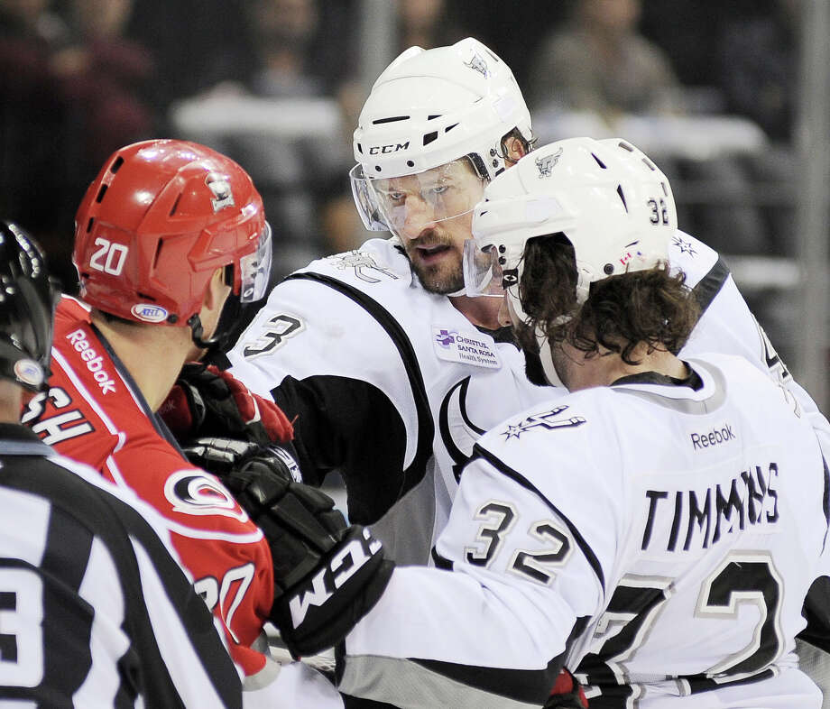 San Antonio Rampage captain Nolan Yonkman, center, and Rampage's Scott Timmins, challenge Charlotte Checkers' Riley Nash, left, during an AHL hockey game, Sunday, Dec. 16, 2012, in San Antonio. Charlotte won 2-1. Photo: Darren Abate, Darren Abate/pressphotointl.com / Darren Abate/pressphotointl.com