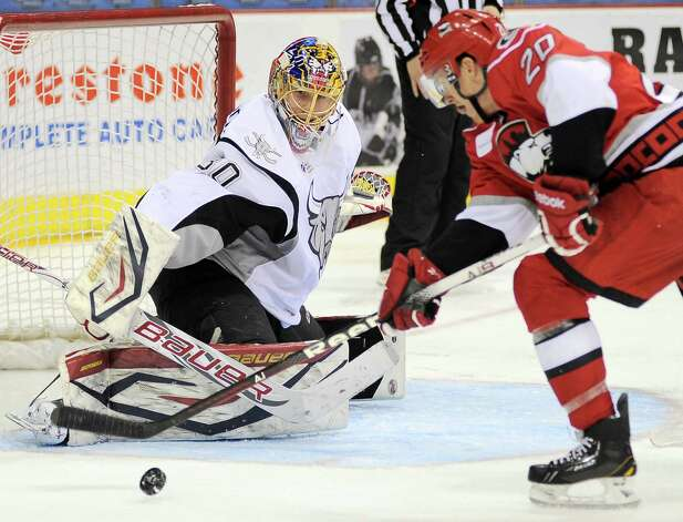 San Antonio Rampage goaltender Jacob Markstrom, left, makes a save on Charlotte Checkers' Riley Nash during an AHL hockey game, Sunday, Dec. 16, 2012, in San Antonio. Charlotte won 2-1. Photo: Darren Abate, Darren Abate/pressphotointl.com / Darren Abate/pressphotointl.com