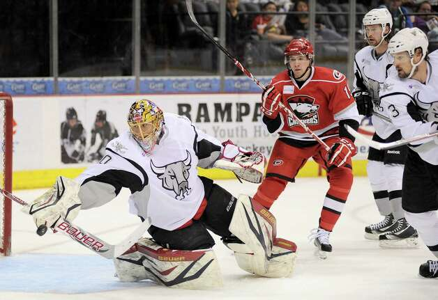 San Antonio Rampage goaltender Jacob Markstrom, left, makes a save during an AHL hockey game against the Charlotte Checkers, Sunday, Dec. 16, 2012, in San Antonio. Charlotte won 2-1. Photo: Darren Abate, Darren Abate/pressphotointl.com / Darren Abate/pressphotointl.com