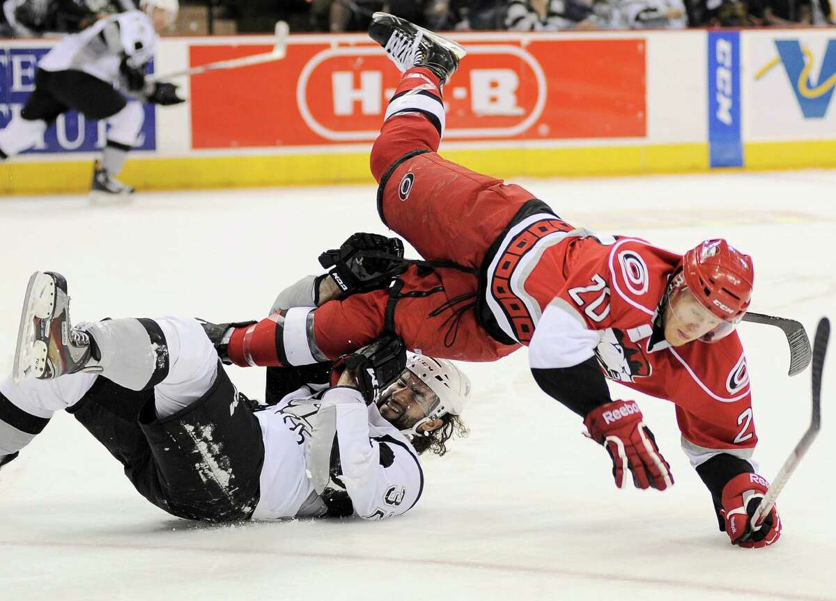 Charlotte Checkers' Riley Nash (20) and San Antonio Rampage's Scott Timmins collide during an AHL hockey game, Sunday, Dec. 16, 2012, in San Antonio. Charlotte won 2-1.