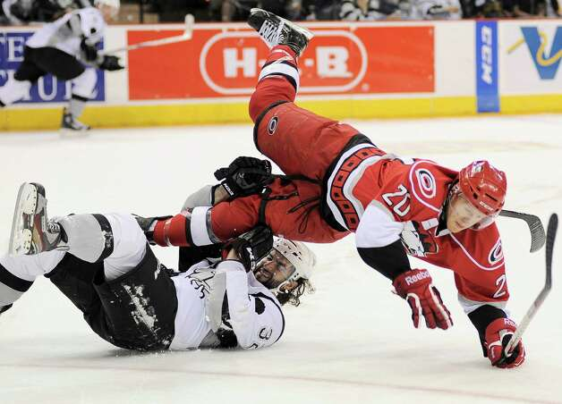 Charlotte Checkers' Riley Nash (20) and San Antonio Rampage's Scott Timmins collide during an AHL hockey game, Sunday, Dec. 16, 2012, in San Antonio. Charlotte won 2-1. Photo: Darren Abate, Darren Abate/pressphotointl.com / Darren Abate/pressphotointl.com
