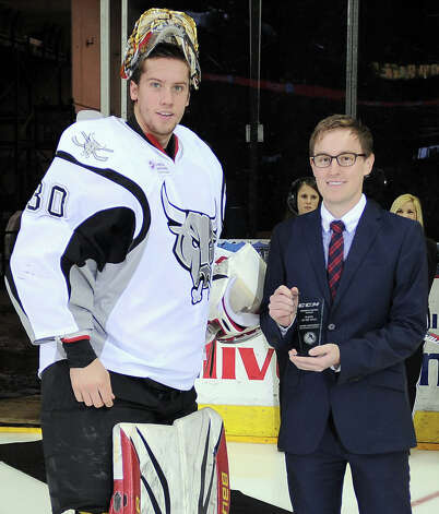 San Antonio Rampage goaltender Jacob Markstrom, left, is presented with an AHL Player of the Week award by Rampage media services manager Alex DiFilippo before an AHL hockey game against the Charlotte Checkers, Sunday, Dec. 16, 2012, in San Antonio. Charlotte won 2-1. Photo: Darren Abate, Darren Abate/pressphotointl.com / Darren Abate/pressphotointl.com