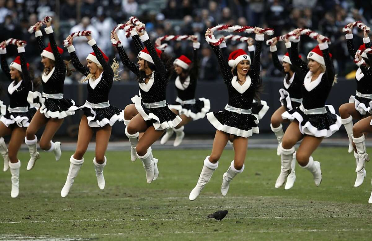 The Oakland Raiderettes perform a Christmas routine in 2012. One of the Raiderettes is now accusing the team of short-changing the cheerleaders in pay.