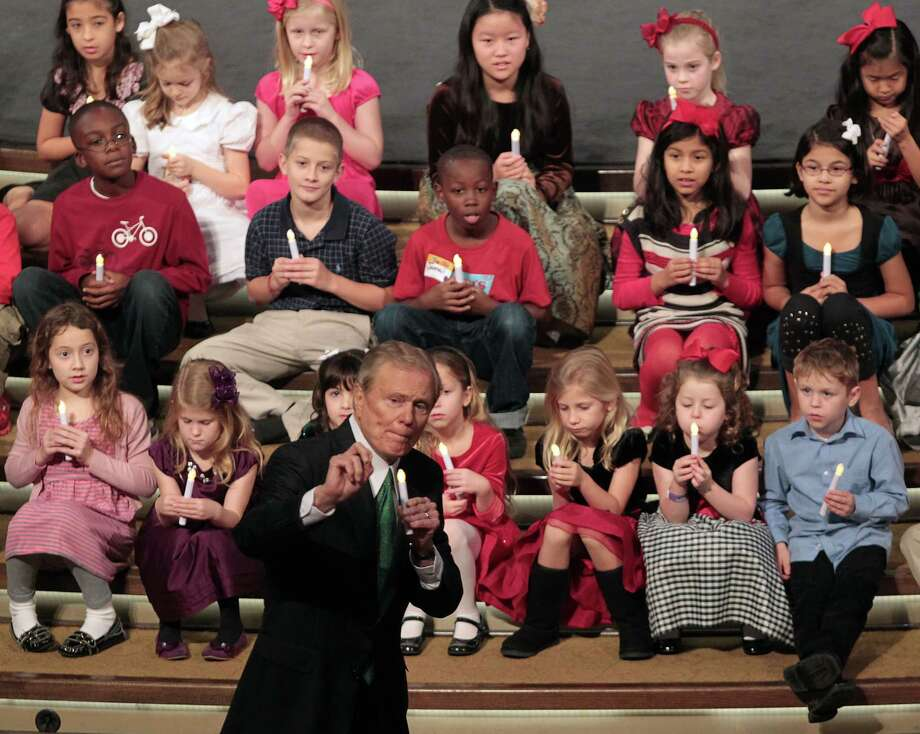 The Rev. Ed Young speaks to children about doing unto others as you would done to you during services at Second Baptist Church. later in the sermon Young spoke of the Connecticut shootings Sunday, Dec. 16, 2012, in Houston. Photo: James Nielsen, Staff / © Houston Chronicle 2012