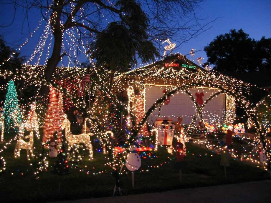 1026 Houghton Ct. San Jose, Santa Clara County, 95112Thousands of multi-colored lights coming down from 35 feet above the roof. The display includes animated lighted characters, handmade wood figures painted by local children in the past. (lightsofthevalley.com)