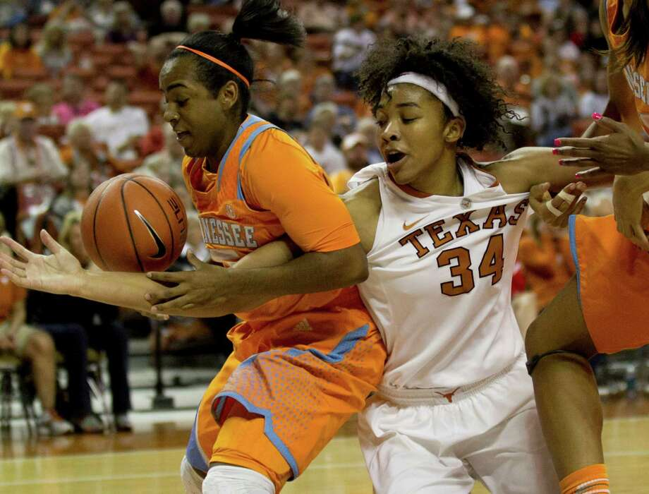 Tennessee's Ariel Massengale, left, must contend with the reach of Imani McGee-Stafford. Photo: Jay Janner, MBR / Austin American-Statesman