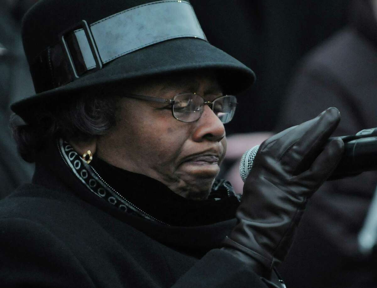 The Rev. Diana Fletcher, with AME Zion Church in Gloversville, becomes emotional as she leads a prayer during a candlelight prayer vigil outside of city hall on Sunday, Dec. 16, 2012 in Schenectady, NY. The vigil was held to show support for the families and community members of Newtown, CT. The vigil was organized by the Hamilton Hill Neighborhood Association. (Paul Buckowski / Times Union)
