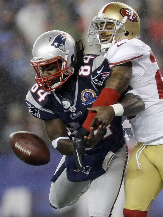 San Francisco 49ers cornerback Tarell Brown, right, breaks up a pass in the end zone intended for New England Patriots wide receiver Deion Branch (84) in the second quarter of an NFL football game in Foxborough, Mass., Sunday, Dec. 16, 2012.  (Elise Amendola / Associated Press)